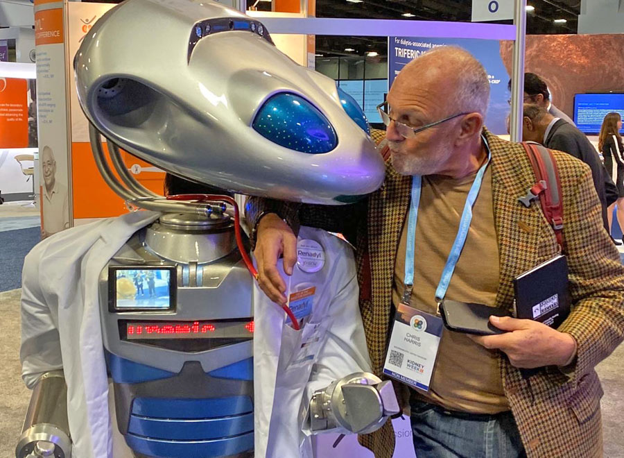 Robot Millennia kissing Kibow Pharma Trade Show attendee