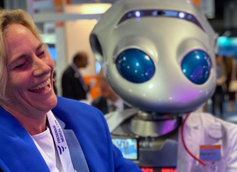 Robot Millennia cracks up woman at trade show